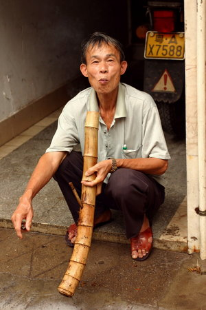 smoking_a_bamboo_pipe_by_beloutte.jpg